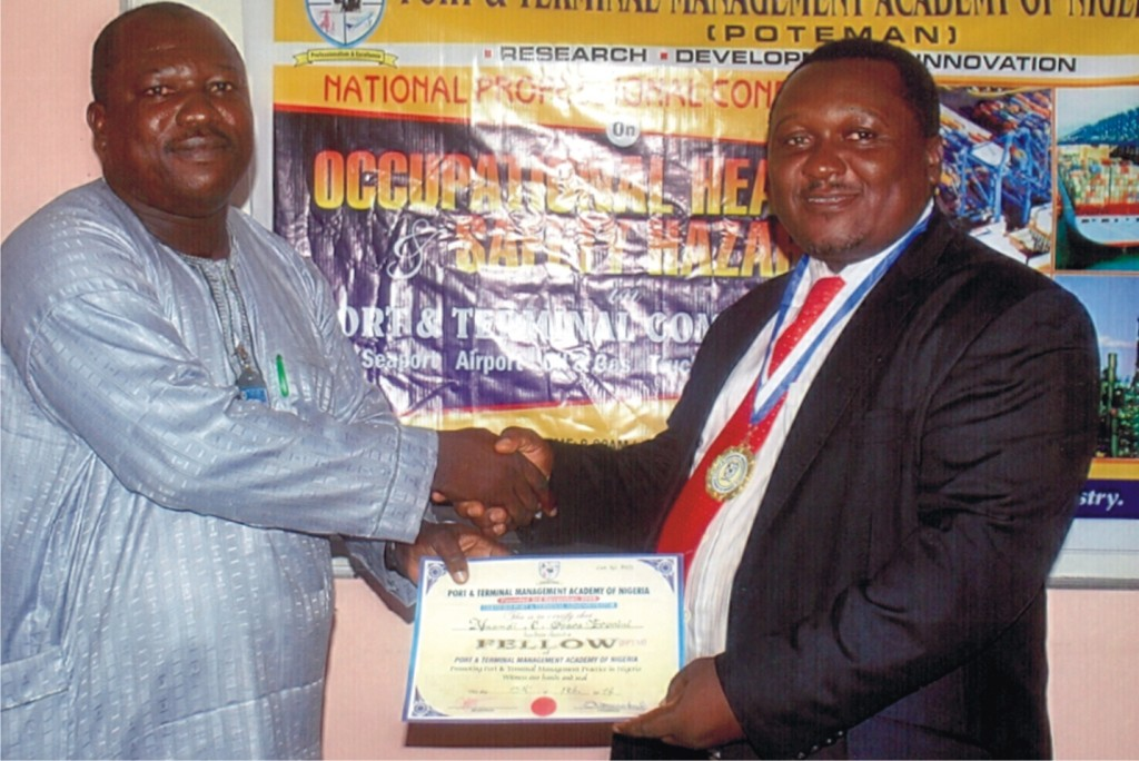 R-L: The General Manager, Nigerian Chamber of Shipping, Mr. Nnamdi Eronini receiving the certificate and other insignia for conferment of the Fellowship of the Port & Terminal Management Academy of Nigeria (POTEMAN) by the Registrar, Dr. Samuel Babatunde