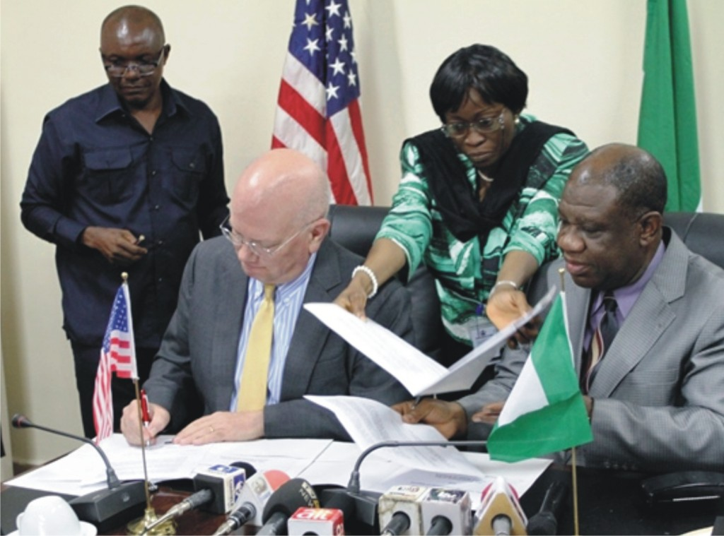 Nigeria, U.S. Sign Memorandum of Understanding on Electric Power on July 25, 2014. Ambassador James F. Entwistle and Power Minister Prof Nebo