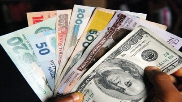 Naira gains, exchanges for N457/$