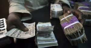 Naira gains, exchanges 430/$ as forex sale resumes