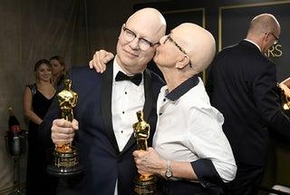 Obamas' first film wins best documentary Oscar